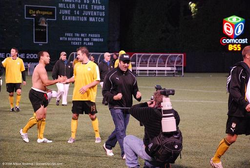 Hollywood United coach Ian Carrington celebrates his club's upset win over the Portland Timbers. Photo: Allison Andrews