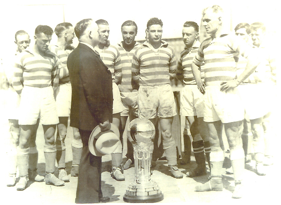 The Fall River Marksmen are presented with the Dewar Trophy after winning the 1931 National Challenge Cup. Photo: National Soccer Hall of Fame
