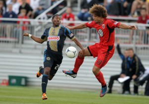 Nick DeLeon (18) of DC United pulls the ball away from Raymon Gaddis (28) of the Philadelphia Union during Tuesday's US Open Cup match. Photo: Tony Quinn | DC United