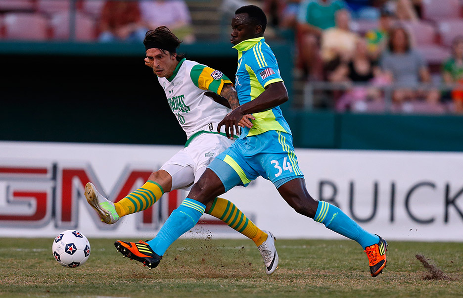 Tampa Bay's Georgi Hristov fights to control the ball with Seattle's Jhon Kennedy Hurtado. Hristov scored in the 75th minute for the Rowdies, the game's only goal.