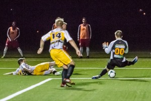 New York's Scott Thomsen opened the scoring by nutmugging Vermont Voltage goalkeeper Aleksandar Djekic. Photo: Bob Larson