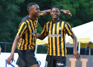 Andre Lewis (right) of Jamaica congratulates Cuban teammate Heviel Cordoves after assisting him for Cordoves first goal of the night. Cordoves scored three times to lead Charleston Battery of USL PRO to a 4-0 win Wednesday over the Panama City Beach Pirates of PDL. Photo:  Janet Edens Conover/CHSSoccer.net.