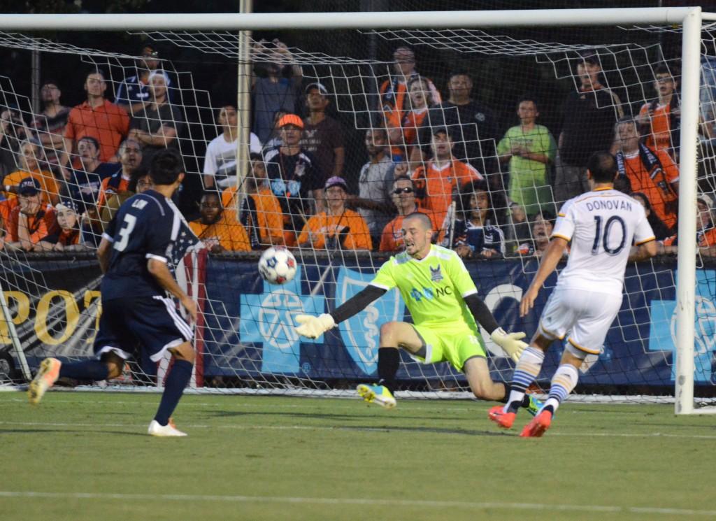Carolina Railhawks goalkeeper Scott Goodwin saves the shot of Los Angeles Galaxy forward Landon Donovan. Photo: Carolina RailHawks
