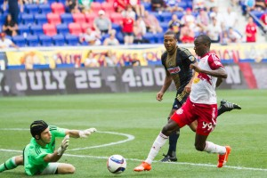John McCarthy of the Philadelphia Union stops a run by the Red Bulls' Bradley Wright-Phillips. Photo: Bob Larson | Stellar Performance Photography | FULL GALLERY
