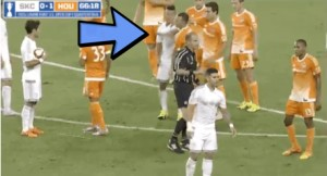 In this video screen shot, Roger Espinoza of Sporting Kansas City appears to punch the Houston Dynamo's Brad Davis