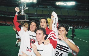 Players from D.C. United celebrate the club's 1996 US Open Cup championship.