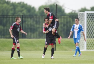 2013 US Open Cup: D.C. United's Dwayne De Rosario celebrates with John Thorrington and Taylor Kemp after scoring a goal against the Philadelphia Union. Photo: DC United