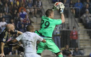 Tim Melia of Sporting KC collects the ball in traffic during the 2015 US Open Cup. Photo: Henry Hauck Jr.   Sporting KC