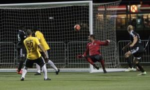 FC Tucson's Dom Papa (right) opens the scoring by sending a cross past San Nicolas goalkeeper Jose Miranda. Photo: Dulce Santamaria Vega