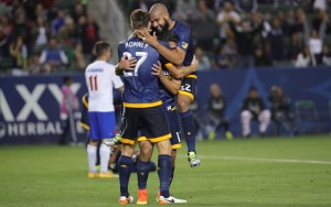 Dave Romney of the LA Galaxy celebrates his goal against La Maquina in the 2016 US Open Cup. Teammate Jose Villarreal is shown injured in the background. Photo: LA Galaxy