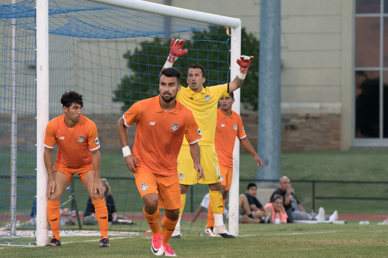 Fabian Cerda of the Tulsa Roughnecks (yellow) gets ready for a corner kick against San Antonio FC in the Third Round of the 2017 US Open Cup. Credit: Lori Scholl