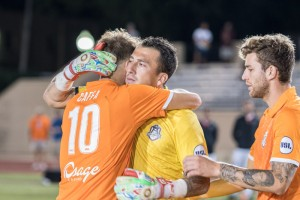 Fabian Cerda of the Tulsa Roughnecks (yellow) gets a hug from a teammate prior to the team's penalty kick shootout against San Antonio FC in the Third Round of the 2017 US Open Cup. Credit: Lori Scholl