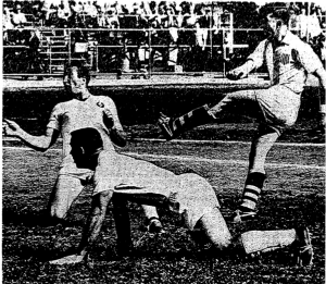 San Francisco Greek American AC player Tom Dawkins takes a shot while Bayardo Abaunza (left) and Lorenz Lenhardt (center) of Los Angeles Kickers-Victoria look on during the Kickers' 3-1 second leg win in 1965. Photo: LA Times archives
