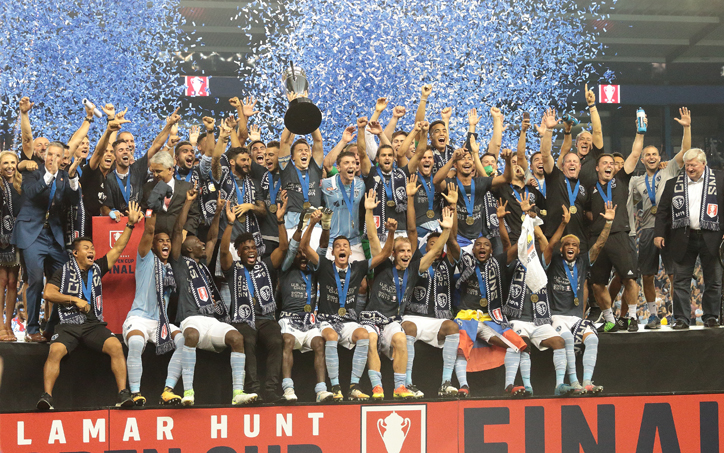 ed87d9d99ce Sporting Kansas City celebrates after defeating the New York Red Bulls 2-1  in the