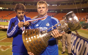 Kansas City Wizards rookie Justin Detter holds the Dewar Trophy after the team won the 2004 Lamar Hunt US Open Cup. Photo: Sporting Kansas City