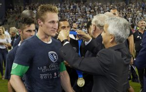 Sporting Kansas City goalkeeper Tim Melia receives his 2017 US Open Cup championship medal from US Soccer president Sunil Gulati. Photo: Sporting KC