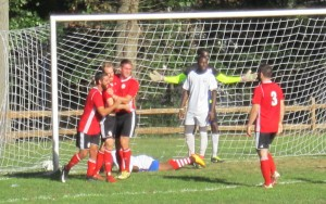 United German Hungarians (red) celebrate a goal by John Gravelle against the Junior Lone Star U-23s in a 2018 US Open Cup qualifying match. Photo: Kari Berton