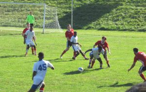 Junior Lone Star U-23s (white) battle with United German Hungarians (red) in 2018 US Open Cup qualifying. Photo: Kari Berton