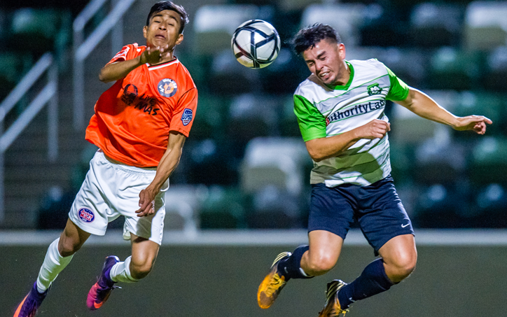 Players from the LA Wolves FC and Buena Park FC go up for a header in a 2018 US Open Cup qualifying match. Photo: Tmesis FC