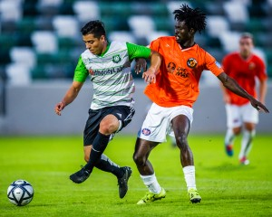 Players from the LA Wolves FC and Buena Park FC battle for the ball in a 2018 US Open Cup qualifying match. Photo: Tmesis FC