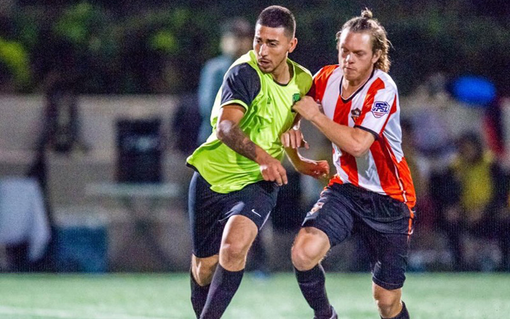 Kyle O'Brien (orange) of Santa Ana Winds battles for the ball in a 2018 US Open Cup qualifier against the San Pedro Monsters. Photo: Santa Ana Winds