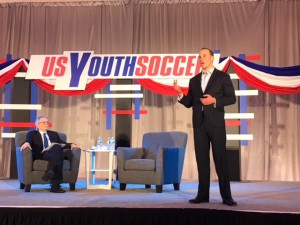 Michael Winograd (right) addresses the crowd at a US Soccer presidential candidate forum put on by US Youth Soccer at the 2018 United Soccer Coaches Convention in Philadelphia. Photo: Chris Moore, US Youth Soccer
