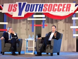 Eric Wynalda (right) addresses the crowd at a US Soccer presidential candidate forum put on by US Youth Soccer at the 2018 United Soccer Coaches Convention in Philadelphia. Photo: Chris Moore, US Youth Soccer