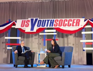 Hope Solo (right) answers a question from moderator JP Dellacamera at a US Soccer presidential candidate forum put on by US Youth Soccer at the 2018 United Soccer Coaches Convention in Philadelphia. Photo: Chris Moore, US Youth Soccer