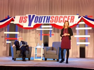 Kathy Carter (right) addresses the crowd at a US Soccer presidential candidate forum put on by US Youth Soccer at the 2018 United Soccer Coaches Convention in Philadelphia. Photo: Chris Moore, US Youth Soccer