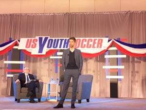 Kyle Martino (right) addresses the crowd at a US Soccer presidential candidate forum put on by US Youth Soccer at the 2018 United Soccer Coaches Convention in Philadelphia. Photo: Chris Moore, US Youth Soccer