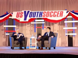Steve Gans (right) answers a question from moderator JP Dellacamera at a US Soccer presidential candidate forum put on by US Youth Soccer at the 2018 United Soccer Coaches Convention in Philadelphia. Photo: Chris Moore, US Youth Soccer