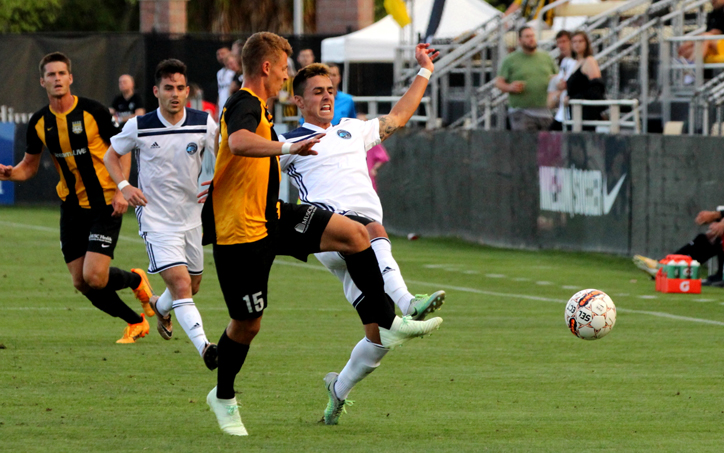 Players from the Charleston Battery and the Elm City Express battle for the ball in a Third Round match in the 2018 US Open Cup. Photo: Ross Almers Photography