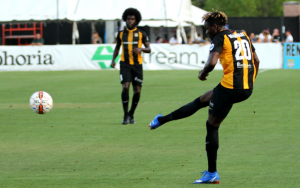 Victor Mansaray of the Charleston Battery delivers a cross in a 2018 US Open Cup match against South Georgia Tormenta FC. Photo: Ross Almers Photography