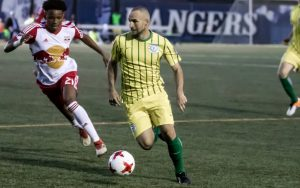 Dilly Duka of FC Motown dribbles against the New York Red Bulls U-23s in the 2018 US Open Cup. Photo: Bob Larson | TheCup.us