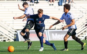 FC Denver players (white) battle for the ball during an exhibition game with Saint Louis FC of the USL. Photo: FC Denver