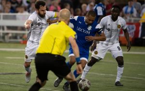 Players from the Pittsburgh Riverhounds and the Erie Commodores (blue) battle for the ball in the Second Round of the 2018 US Open Cup. Photo: Jennifer White | Acacia Studios