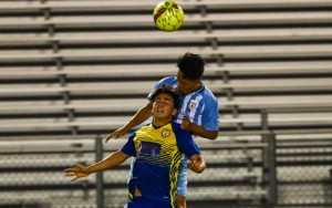 Players from Sporting AZ (blue) and FC Arizona challenge for the ball in the 2018 US Open Cup. Photo: Arianna Grainey