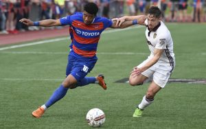 Emery Welshman of FC Cincinnati battles for the ball with a Detroit City FC player in a Second Round match in the 2018 US Open Cup. Photo: Brett Hansbauer   4th Floor Creative