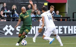 Samuel Armenteros of the Portland Timbers dribbles the ball against Servando Carrasco of the LA Galaxy in the Fifth Round of the 2018 US Open Cup. Photo: Allison Andrews | SoccerCityUSA.com