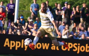 Brian Ownby of Louisville City FC controls the ball against the New England Revolution in the Fourth Round of the 2018 US Open Cup. Photo: EM Dash Photography