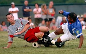 Kiley Couch of Dallas Roma FC (left) challenges for the ball against Romario of Miami FC during their Second Round match during the 2006 US Open Cup. Photo: Dallas Roma FC