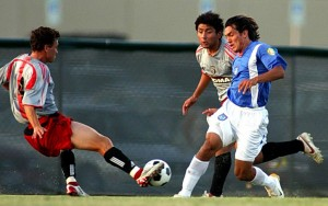 Wilco Ravestijn of Dallas Roma FC plays the ball against Miami FC as teammate Alex Funez looks on in their Second Round match in the 2006 US Open Cup. Photo: Dallas Roma FC.