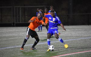 Players from World Class Premier (orange) and Izee Auto FC battle for the ball in a 2019 US Open Cup qualifying match. Photo: Craig Tower