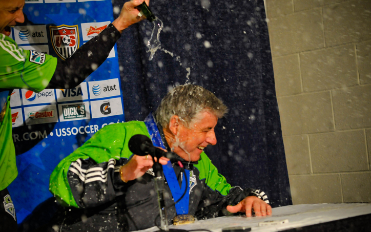 Sigi Schmid of the Seattle Sounders FC is showered with champagne during his post-game preference after winning the 2010 Lamar Hunt US Open Cup championship.