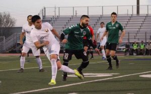 Players from FC Denver (green) and Southwest FC battle for the ball in a Fourth Round match in the Open Division Local qualifying tournament for the 2019 US Open Cup. Photo: James Clifton