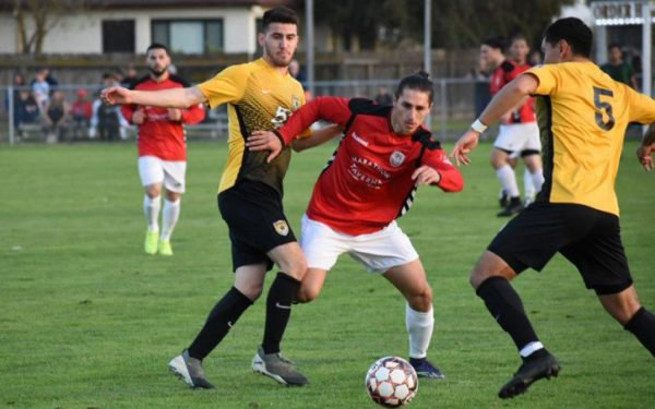 Players from IPS Marathon Taverna (red) and Academica SC battle for the ball in a Fourth Round match in the Open Division Local qualifying tournament for the 2019 US Open Cup. Photo: Brittney Virgo