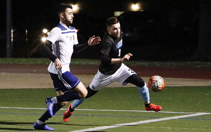 Players from West Chester United (right) and Safira FC battle for the ball during their Fourth Round match in the 2019 US Open Cup Open Division Local qualifying tournament. Photo: Chris Aduama