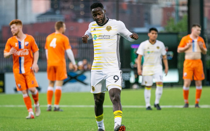 Neco Brett of the Pittsburgh Riverhounds celebrates after scoring a penalty kick goal in the 57th minute against Dayton Dutch Lions in the Second Round of the 2019 US Open Cup. Photo: Chris Cowger | Pittsburgh Riverhounds