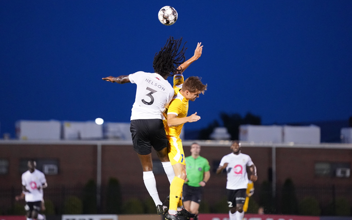 Kyle Nelson of the Charleston Battery (No. 3) challenges for a header against Nashville SC in a Third Round match in the 2019 US Open Cup. Photo: Jay Wilkinson | Nashville SC