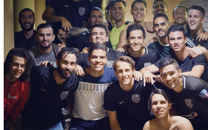 Florida Soccer Soldiers celebrate in the locker room after a game. Photo: Lee Ifans